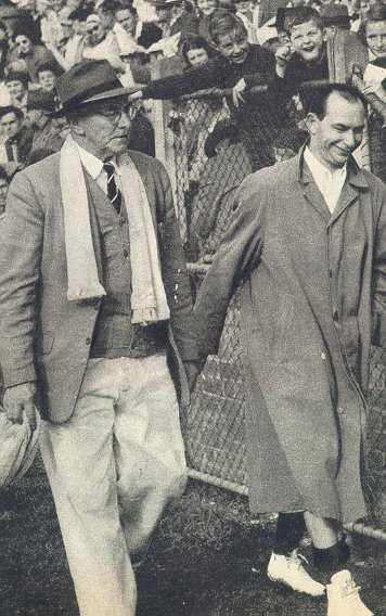 Harry Beitzel leaves Glenferrie Oval after suffering a leg injury in 1957.